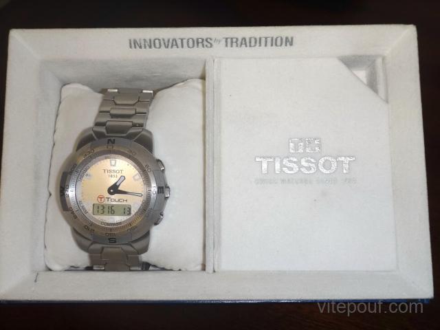 Montre Suisse de marque TISSOT, modèle T-TOUCH.